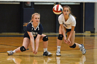 Jill Schweizer (6) and Grace Schweizer (8) go for dig in Lady Indians' upset win over Pennsbury Oct. 3 at Council Rock North, Newtown, Pa. (John Gleeson – 21st-Century Media)