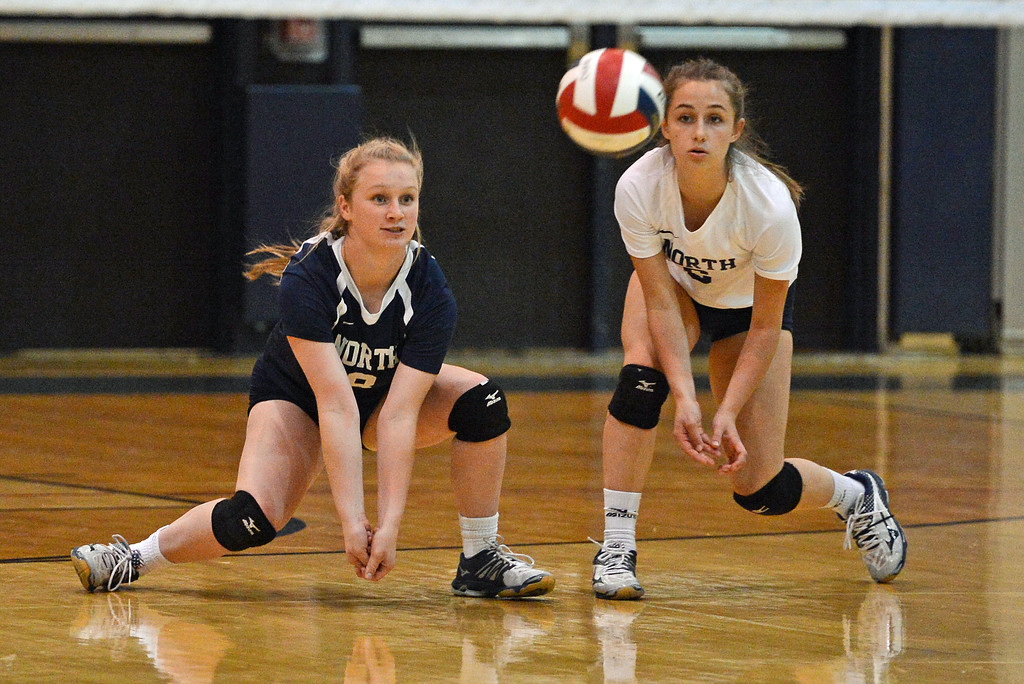 . Jill Schweizer (6) and Grace Schweizer (8) go for dig in Lady Indians\' upset win over Pennsbury Oct. 3 at Council Rock North, Newtown, Pa. (John Gleeson � 21st-Century Media)