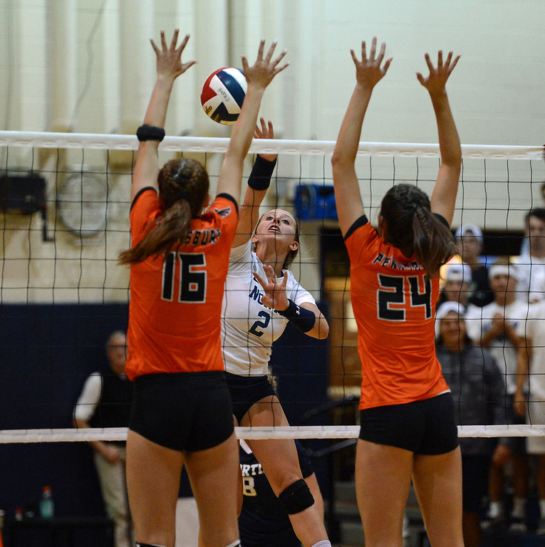 . Maddy Moore (2) scored 13 kills. Shelby Hastings (16) and Elley Torres (24) defend for Pennsbury.