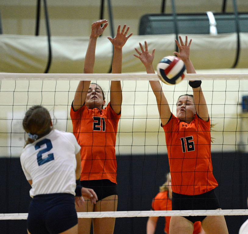 . Julie Vreeswyk (21) and Shelby Hastings (16) combine for save.