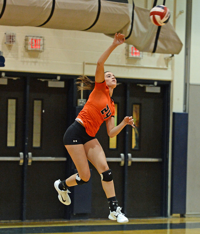 . Elley Torres (24) gets everything into serve for Pennsbury.
