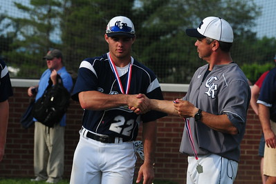 Council Rock North senior Tyler Nowmos, left, is congratulated by Indians head coach Matt Schram after the conclusion of the District 1-AAAA championship game June 2 at Methacton High's Robert Morris Childress Field. (Steve Sherman – 21st-Century Media)