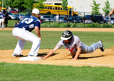 Tigers infielder Scott Hahn, right, gets back to first base in time in PIAA quarterfinal battle against Marple Newtown Thursday, June 9 at Immaculata University.