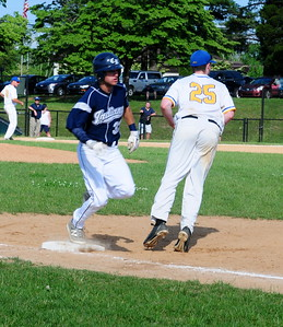 Council Rock North outfielder Jackson Parker, left, crosses first base in District 1-AAAA semifinal win over the Whippets May 31 at Methacton High's Robert Morris Childress Field.