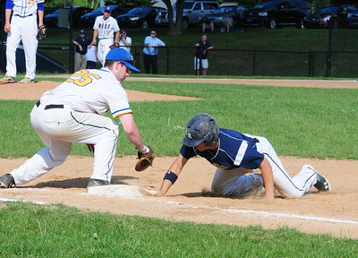Downingtown West first baseman Reyce Curnane (#25), left, keeps Council Rock North baserunner close in District 1-AAAA semifinal win over the Whippets May 31 at Methacton High's Robert Morris Childress Field.