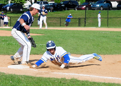 Council Rock North first baseman Chase D'Arcangelo, left, keeps Downingtown West centerfielder John Paul Bell close to the bag in District 1-AAAA semifinal win over the Whippets May 31 at Methacton High's Robert Morris Childress Field.