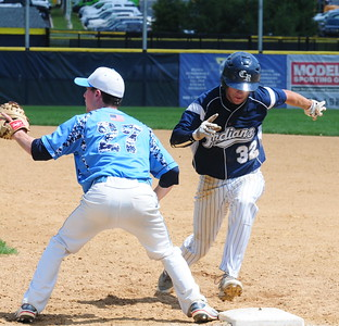 Council Rock North senior Jackson Parker (#32), right, gets back to first base in time in the PIAA opener against Father Judge June 6 at Neumann University.