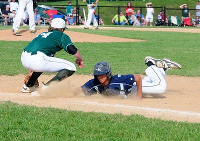 Council Rock North pinch-runner Alan Browning, right, gets back under the tag of Rams first baseman Andrew Horne in the District 1-AAAA Championship game June 2 at Methacton High's Robert Morris Childress Field.