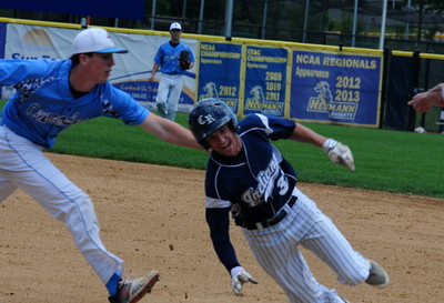 Council Rock North senior Jackson Parker (#32), right, gets caught in a rundown in the PIAA opener against Father Judge June 6 at Neumann University.