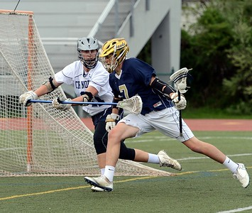 CR North's Mike Gartner (11) stick checks Peter Mignacca (7).