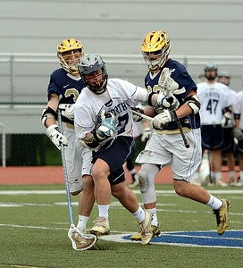 CR North senior Colin Slavtcheff (27) breaks away after winning faceoff.