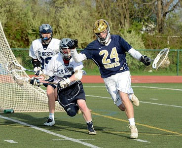South's Adam Reifer (24) shields ball from Jack Earley (31).