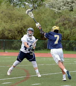 Rob Kay (44) clears ball over Peter Mignacca (7).