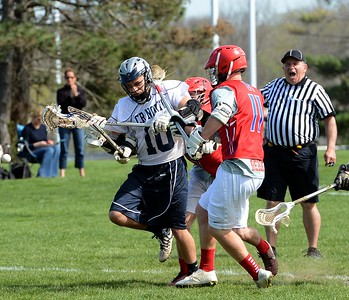 Neshaminy's TJ Daino (11)  jars ball from Ian Watkins (10).