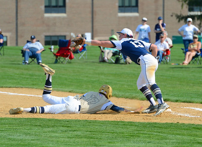 CR South baserunner Josh Kim (17) slides safely as ball eludes glove of Nolan Hartwell (13).
