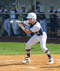 CR North batter Cole Olshavsky (18) lays down bunt.