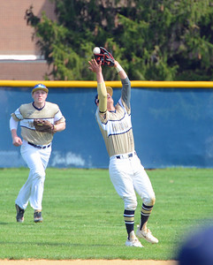 Trey Obarowski (13) hauls in pop fly at second base.