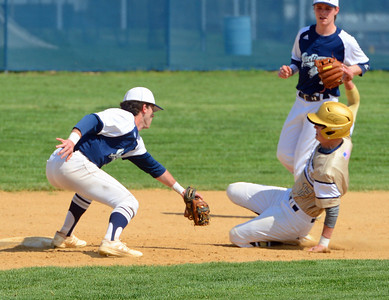 Council Rock North shortstop Cavan Tully (22) gets set to tag out South baserunner Trey Obarowski (13) in Indians' win over the Golden Hawks April 6 on North's home field. (John Gleeson – 21st-Century Media)