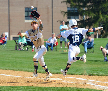 CR North baserunner Cole Olshavsky (18) beats throw to Trey Obarowski (13).