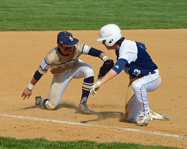 CR South infielder Josh Kim (17) applies pickoff tag to Nolan Hartwell (13).