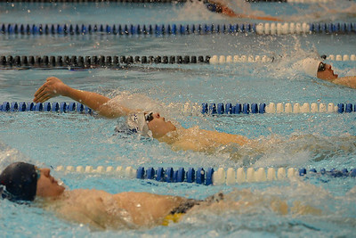 North's Zach Birbeck reaches out in 100 backstroke.