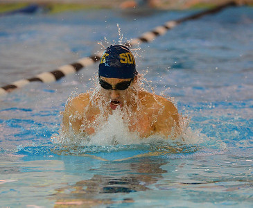 Josh Belder swims breaststroke leg of relay race for South.