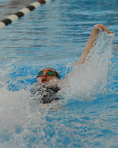 Madison Peifer swims backstroke for South's medley relay team.