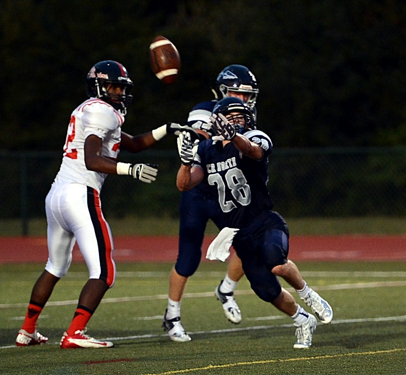 . Junior Mike Welde (28) goes all out to block the extra point.
