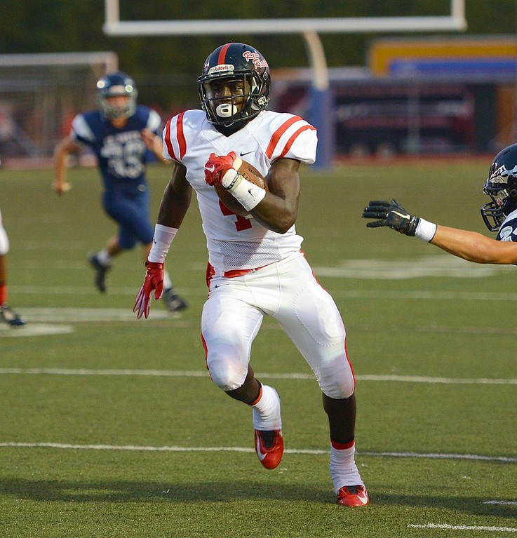 . Raiders running back Aaron Young (#4) scored five of Coatesville\'s first six touchdowns.
