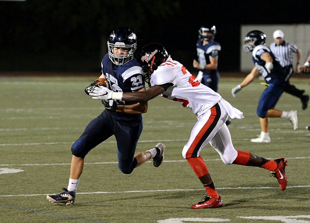 . Senior Kevin Gibson (23) hauls in a short pass.