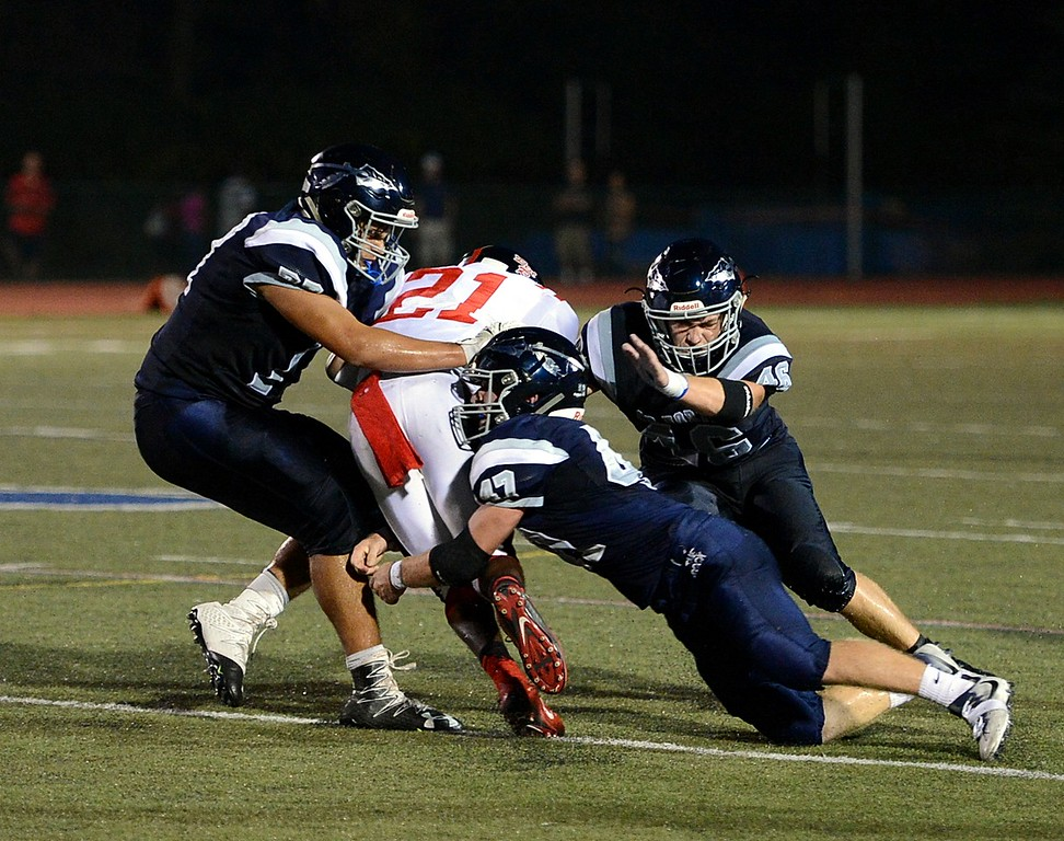 . CR North defenders led by Andrew Kelly (#47) bring down Brandon Talbot (21).