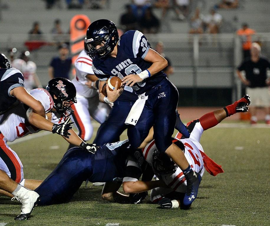 . North quarterback Evan Devine (#10) looks for running room.