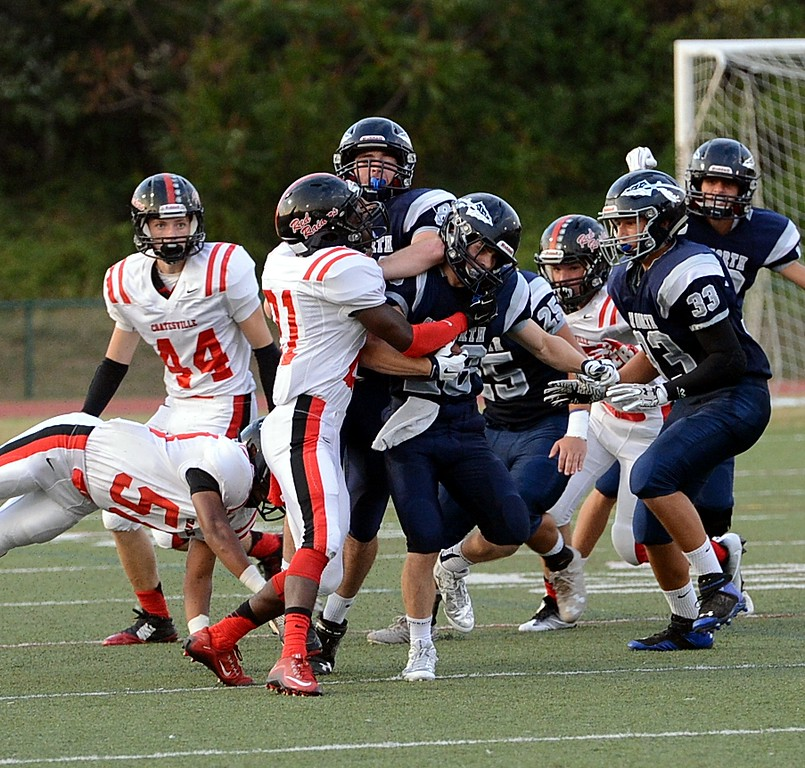 . Junior Mike Welde (#28) is tackled by Frank Sherman (81).