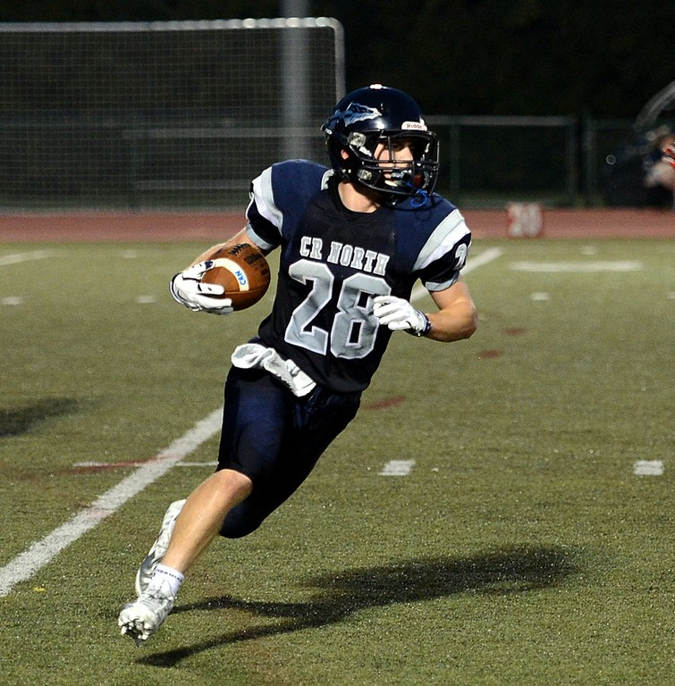 . Junior Mike Welde (28) takes off on 75 yard TD run for the Indians.
