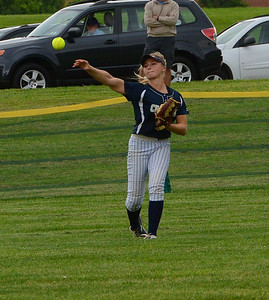 Centerfielder Sabrina Crane (30) makes hard throw to infield.