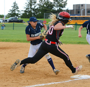 First baseman Lauren Begg (7) cannot quite beat Sarah Reinert (10) to the bag.