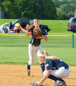 Juliana Shields (4) fires over Madison Tomlinson (9) to get out at first.