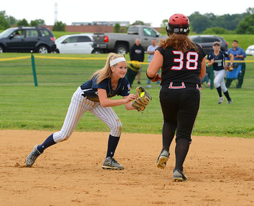 Council Rock North infielder Madison Tomlinson (9) gets set to tag out Boyertown base runner in 3-0 Lady Indians win May 24 at CR North, Newtown, Pa. (John Gleeson – 21st-Century Media)