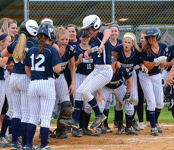 Taylor Briggs (2) celebrates her game-winning homer.