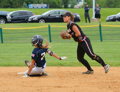 Lauren Begg (7) is forced at second by Alyssa Acker (15).