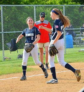 Game heroes Taylor Briggs (2) and Jenna Khantzian (22) celebrate victory.
