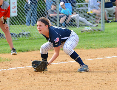 Taylor Briggs (2) is down and ready at third base.