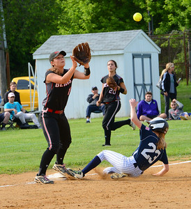 Becca Risenberger (23) beats throw to Alyssa Acker (15).