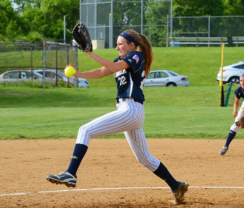 Sophomore Jenna Khantzian (22) gets everything into pitch.