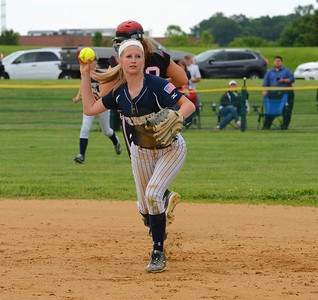 Madison Tomlinson (9) attempts to complete double play.
