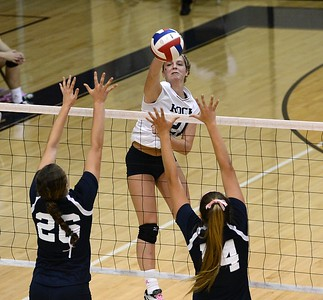Council Rock South's Natalie Kazokas (21) slams ball at Morgan Collito (26) and Mackenzie Tinner (14).