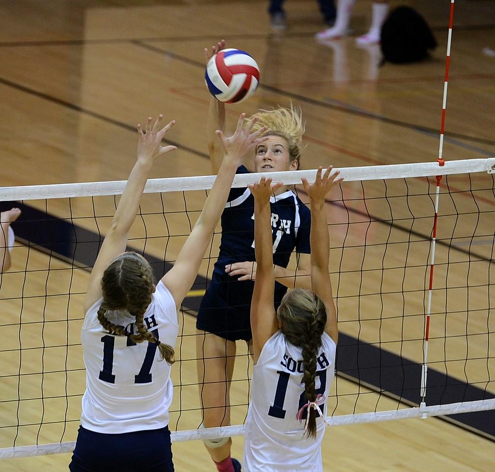 Council Rock North's Katherine Ligos (21) drives ball at Hannah Sullivan (17) and Hannah Devlin (12).