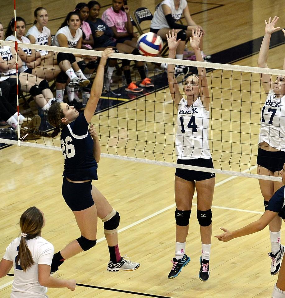 Morgan Collito (26) is defended by Lauren Koestler (14).