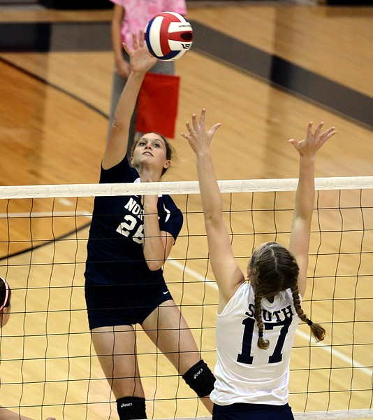 Morgan Collito (26) finesses ball by Hannah Sullivan (17).