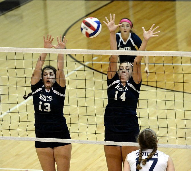 Kaelin Mealey (13) and Mackenzie Tinner (14) play tough at the net.